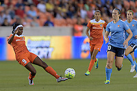 Houston, TX - Friday April 29, 2016: Chioma Ubogagu (9) of the Houston Dash clears the ball in front of Ashley Nick (10) of Sky Blue FC at BBVA Compass Stadium. The Houston Dash tied Sky Blue FC 0-0.