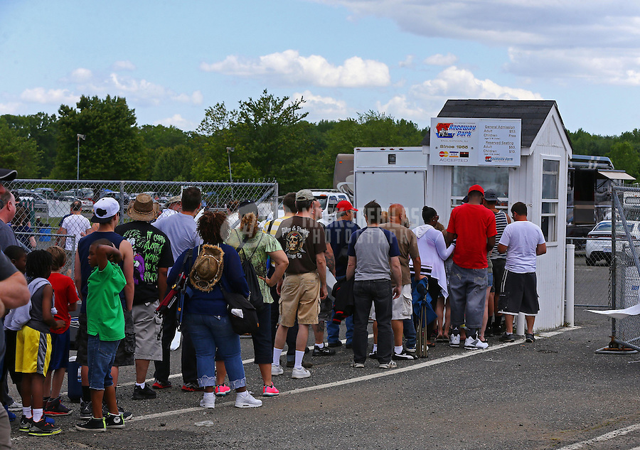 May 31, 2014; Englishtown, NJ, USA; NHRA fans line up to buy a ticket at a ticket booth during qualifying for the Summernationals at Raceway Park. Mandatory Credit: Mark J. Rebilas-