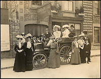 BNPS.co.uk (01202 558833)<br /> Pic: PhilYeomans/BNPS<br /> <br /> The recently discovered photograph from 1903 showing 'Fiery Liz' being used for an Edwardian wedding.<br /> <br /> Staff at the Haynes motor museum have dusted off what is thought to be Britains first wedding car, after the remarkable discovery in New Zealand of a 110 year old wedding snap.<br /> <br /> The museum's research has unearthed the Edwardian photograph of the old Daimler at the 1903 wedding between a Mr James Andrews and Miss Rosa Gough in Weston-Super-Mare - thought to be the first time a car was used for as wedding transport in Britain.<br /> <br /> The 1897 British built Daimler Wagonette dates from the very earliest days of motoring when the phrase 'Horseless carriage' was very apt. Its rudimentary 2 cylinder petrol engine only produced 6.5hp giving a top speed of only 11.6mph. <br /> <br /> The car featured cart wheels with solid tyres, a metal rod that functioned as a 'hand' brake, leather mud flaps and cart springs...and the brakes were rubber blocks that gripped the tyres.