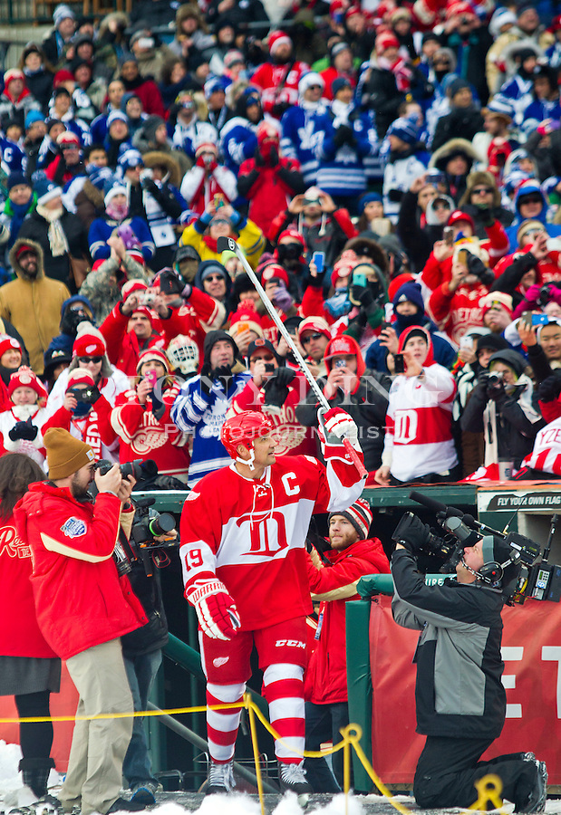31 December 2013: Former Detroit Red Wings forward Steve Yzerman (19) waves his stick to acknowledge fans as he is introduced before the Toronto Maple Leafs v Detroit Red Wings Alumni Showdown hockey game, at Comerica Park, in Detroit, MI.