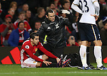 The Manchester Utd physic signals for a stretcher for Henrikh Mkhitaryan of Manchester United during the English Premier League match at Old Trafford Stadium, Manchester. Picture date: December 11th, 2016. Pic Simon Bellis/Sportimage