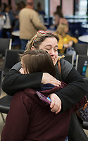 NWA Democrat-Gazette/CHARLIE KAIJO Michelle Belden of Gentry (right) hugs her daughter, seventh grader, Sarah Belden after receiving a certificate for achieving the honor roll during an awards assembly, Friday, January 11, 2019 at the Arkansas Arts Academy in Rogers. <br />