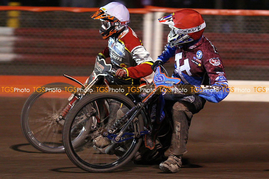 Heat 12: Kauko Nieminen (red) and Morten Risager (white) - Lakeside Hammers vs Swindon Robins, Elite League Speedway at the Arena Essex Raceway, Purfleet - 23/04/10 - MANDATORY CREDIT: Rob Newell/TGSPHOTO - Self billing applies where appropriate - 0845 094 6026 - contact@tgsphoto.co.uk - NO UNPAID USE.