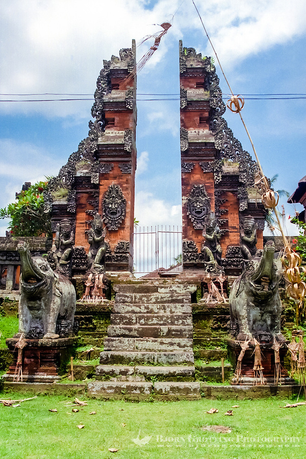 Bali, Tabanan. A temple with the characteristic split gate, elephants are guarding the entrance. South of Tabanan city.