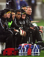 The Phoenix bench and management watch the match in the pouring rain during the A-League football match between Wellington Phoenix and Perth Glory at Westpac Stadium, Wellington, New Zealand on Sunday, 16 August 2009. Photo: Dave Lintott / lintottphoto.co.nz