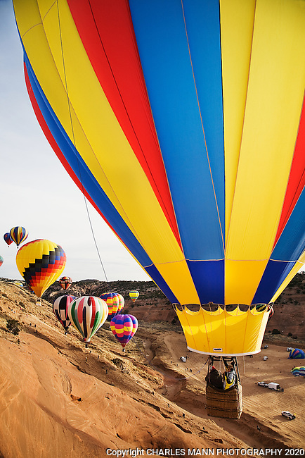The Red Rock Balloon Rally is held each December in Gallup, New Mexico, and features colorful hot air balloons flying against dramatic red sandstone cliffs and desert scenery.