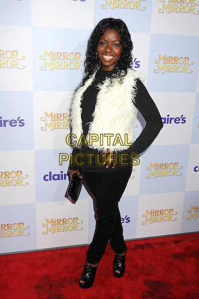 """Camille Winbush.""""Mirror Mirror"""" Los Angeles Premiere held at Grauman's Chinese Theatre, Los Angeles, California, USA, .17th March 2012 .full length black white fluffy gilet .CAP/ADM/BP.©Byron Purvis/AdMedia/Capital Pictures."""