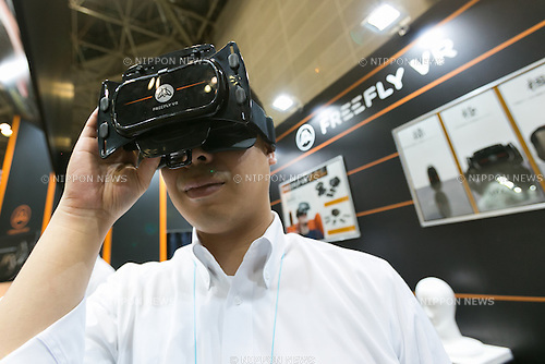 A man tests a ''FREEFLY VR'' virtual reality glasses at the 24th 3D & Virtual Reality Expo (IVR) at Tokyo Big Sight on June 23, 2016, Tokyo, Japan. IVR is  Japan's largest exhibition for 3D and virtual reality technologies and solutions with 80 enterprises exhibiting over three trade show days at Tokyo Big Sight. (Photo by Rodrigo Reyes Marin/AFLO)