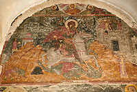 Pictures & images of the medieval fresco of St George over the doorway of the Alaverdi St George Cathedral & monastery complex, 11th century, near Telavi, Georgia (country). <br /> <br /> At 50 meters high Alaverdi St George Cathedral was once the highest cathedral in Georgia (now its the nes Tblisi cathedral). The cathedral is part of a Georgian Orthodox monastery founded by the monk Joseph [Abba] Alaverdeli, who came from Antioch and settled in Alaverdi. On the UNESCO World Heritage Site Tentative List.