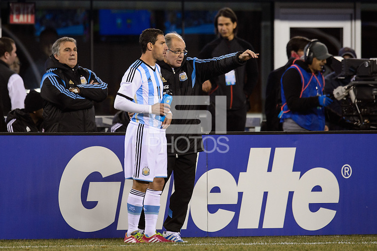 Argentina head coach Alejandro Sabella talks with midfielder Maximiliano Rodriguez (11). Argentina and Ecuador played to a 0-0 tie during an international friendly at MetLife Stadium in East Rutherford, NJ, on November 15, 2013.