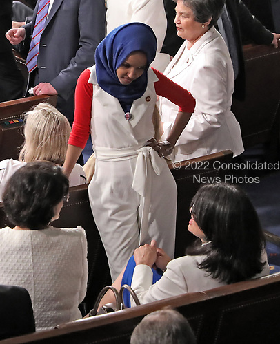 United States Representative Ilhan Omar (Democrat of Minnesota) and US Representative Rashida Tlaib (Democrat of Michigan), lower right, in conversation on the floor prior to the arrival of US President Donald J. Trump who will deliver his second annual State of the Union Address to a joint session of the US Congress in the US Capitol in Washington, DC on Tuesday, February 5, 2019.<br /> Credit: Alex Edelman / CNP
