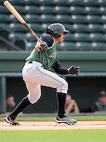 Third baseman Jose Flores (29) of the Augusta GreenJackets, a San Francisco Giants affiliate, in a game against the Greenville Drive on August 22, 2012, at Fluor Field at the West End in Greenville, South Carolina. Augusta won, 6-1. (Tom Priddy/Four Seam Images).
