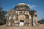 The  Bara Lao Ka Gumbad (Tomb) at Basant Lok, Delhi where illegal occupants where evicted after living there since 1943. The walls had been painted pink, steel doors erected and the place furnished. Security guards now live in the structure to keep former residents from returning.The Archaeological Survey of India has been on a campaign to evict people who have illegally made heritage tombs their homes throughout the city in recent times but is facing stiff opposition from the residents. The area is littered with tombs that need excavation.