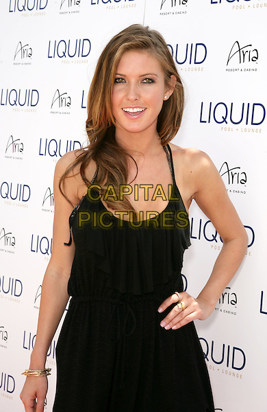 AUDRINA PATRIDGE.Celebrates her 25th Birthday at Liquid Pool Lounge at Aria Resort & Casino at CityCenter, Las Vegas, Nevada, USA, 8th May 2010..half length black dress hand on hip ruffle smiling halterneck .CAP/ADM/MJT.© MJT/AdMedia/Capital Pictures.