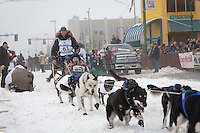 Matt Failor and team leave the ceremonial start line at 4th Avenue and D street in downtown Anchorage during the 2013 Iditarod race. Photo by Jim R. Kohl/IditarodPhotos.com