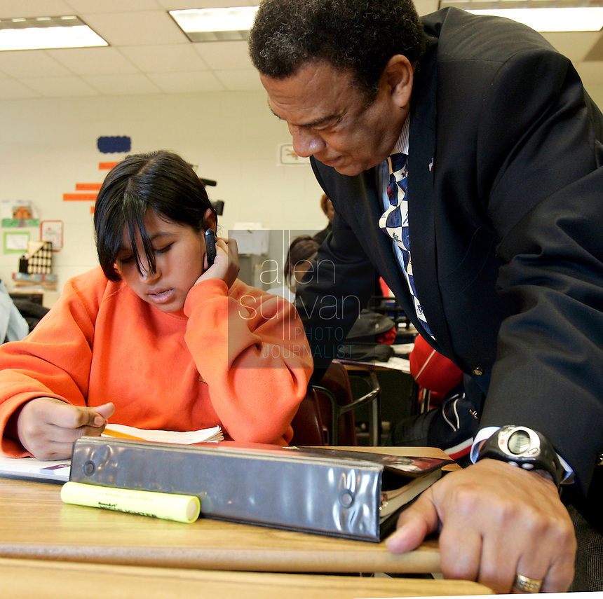 Ambassador Andrew Young listens as Blanca Galaviz reads out loud at Sammye E. Coan Middle School in Atlanta on Monday, Oct. 30, 2006. Young, Fulton County deputy district attorney Ron Dixon and Jerome Russell of H.J. Russell and Company visited the school as part of the Principal for a Day program.<br />
