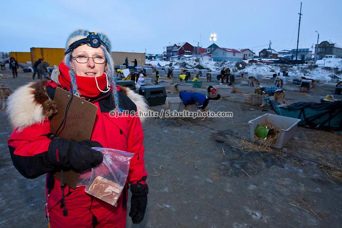 Nome dog lot volunteer coordinator Kathleen Zwolak of Chicago during the 2010 Iditarod