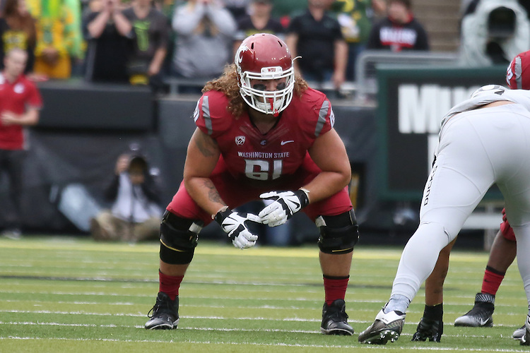 Cole Madison, Washington State University offensive lineman, leads the team out of the tunnel prior to the Cougars Pac-12 conference road game against the Oregon Ducks at Autzen Stadium in Euguene, Oregon, on October 10, 2015.  After tying the game in closing seconds of the fourth quarter, the Cougars defeated the Ducks in double overtime, 45-38.