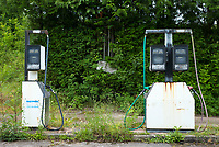 Abandoned Severn Fuels fuel filling station with derelict petrol pumps in Pembrokeshire, Wales, UK