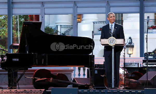 United States President Barack Obama delivers remarks at the International Jazz Day Concert on the South Lawn of the White House, in Washington, DC, April 29, 2016. The event includes a performance by Aretha Franklin and is presented by Morgan Freeman. <br /> Credit: Aude Guerrucci / Pool via CNP/MediaPunch