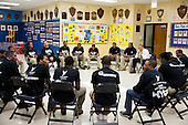 """United States President Barack Obama participates in a """"Becoming a Man"""" program roundtable at the Hyde Park Career Academy in Chicago, Illinois, February 15, 2013..Mandatory Credit: Pete Souza - White House via CNP"""