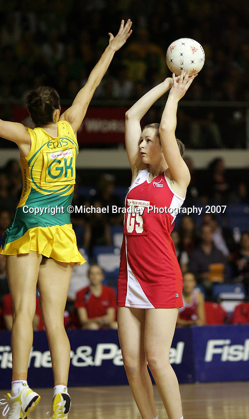 16.11.2007 England's Louisa Brownfield and Australian Liz Ellis in action during the Australia v England match at the New World Netball World Champs held at Trusts Stadium Auckland New Zealand. Mandatory Photo Credit ©Michael Bradley.