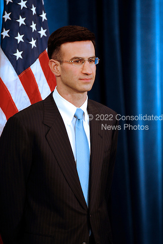 Chicago, IL - November 25, 2008 -- Peter Orszag, Director of the Office of Management and Budget-designate (OMB) looks on as United States President-elect Barack Obama presents his economic team at  his third press conference at the Chicago Hilton & Towers in Chicago, Illinois on Tuesday, November 25, 2008. .Credit: Steve Leonard - Pool via CNP