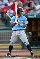 Cheslor Cuthbert (13) of the Northwest Arkansas Naturals stands at bat during a game against the Springfield Cardinals at Hammons Field on August 23, 2013 in Springfield, Missouri. (David Welker/Four Seam Images)