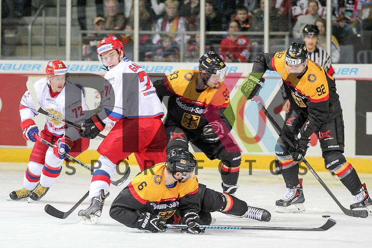 Deutschlands Noebels, Marcel (Nr.92)(Eisb&auml;ren Berlin) mit Puck, Deutschlands Haase, Henry (Nr.6)(Eisb&auml;ren Berlin) am Boden und Deutschlands Raedeke, Brent (Nr.93)(Iserlohn Roosters) im Zweikampf im Spiel IIHF WC15 Germany - Russia.<br /> <br /> Foto &copy; P-I-X.org *** Foto ist honorarpflichtig! *** Auf Anfrage in hoeherer Qualitaet/Aufloesung. Belegexemplar erbeten. Veroeffentlichung ausschliesslich fuer journalistisch-publizistische Zwecke. For editorial use only.