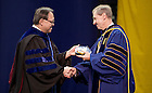 May 18, 2013; John Affleck-Graves, executive vice president of the University of Notre Dame, receives the Arnie Ludwig Executive MBA Outstanding Teacher Award for South Bend during the Mendoza College of Business graduate commencement ceremony at the Purcell Pavilion. Photo by Barbara Johnston/University of Notre Dame