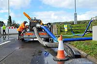 Pictured: Wales natural resources staff working after the flooding caused by Storm Callum, in Abergwili, Carmathen, Wales, UK. Sunday 14 October 2018<br /> Re: The aftermath of the flood caused by the unusually high tide of rover Towy and storm Callum in Carmarthen west Wales, UK.