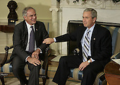 "Washington, D.C. - May 5, 2005 -- Central Intelligence Agency (CIA) Director Porter Goss, left, and United States President George W. Bush sit in the Oval Office to announce that Goss is resigning as director of the CIA May 5, 2006 in Washington, DC. Bush said that he appreciated Goss' ""candid advice"" during his two years as director of the CIA.  <br /> Credit: Chip Somodevilla - Pool via CNP"