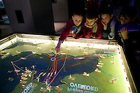 "24 April 2004 - Caen, France - Schoolchildren from Seneffe in Belgium examine a map of the D-Day Overlord operations on display at the Memorial museum in Caen, France, 24 April 2004. The school trip to the museum and then to the D-Day sites is part of a ""Democracy Year"" organized by the teachers."