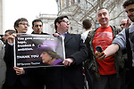 Supporters of Margaret Thatcher with poster 'You gave millions of us hope, freedom &amp; ambition,' next to man wearing 'Hope you burn in hell' T-shirt in St Paul's Churchyard following the funeral of Margaret Thatcher, London, 17 April 2013..<br />