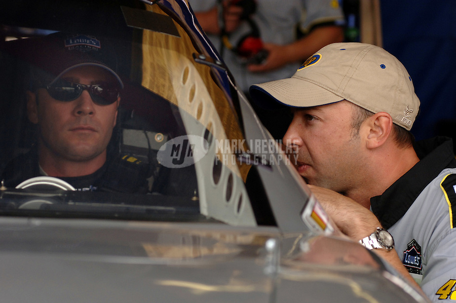 May 5, 2006; Richmond, VA, USA; Nascar Nextel Cup driver Jimmie Johnson (48) talks with crew chief Chad Knaus during practice for the Crown Royal 400 at Richmond International Raceway. Mandatory Credit: Mark J. Rebilas