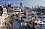 Pier 39 docks wit tourists and tour boats, sailboats and skyline San Francisco, California USA