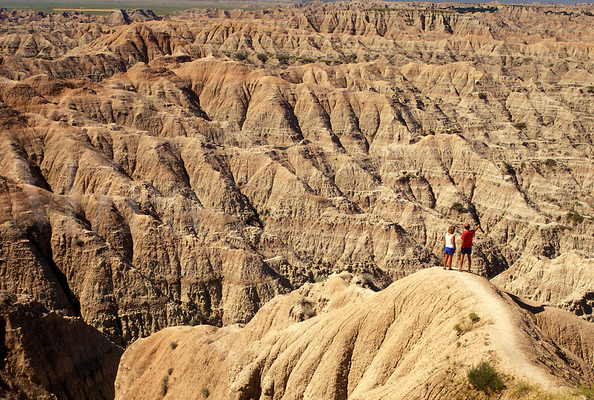 hiking, The Badlands, Badlands National Park, SD, South Dakota, A couple looking at the spectacular landscape of rock formations in Badlands Nat'l Park in South Dakota.