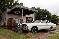 A 1968 Pontiac Bonneville eternally waits for a fill up at the Glenrio Texaco station on the Texas side of town along Route 66. Glenrio straddled the Texas-New Mexico state line and thrived through the 40's, 50's, and 60's until the Interstate bypassed the town in 1975.