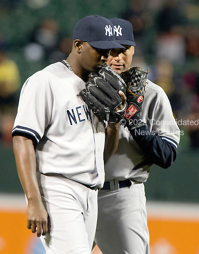 New York Yankees pitcher Rafael Soriano (29), left, discusses strategy with shortstop Derek Jeter (2), right, as he pitches in the ninth inning against the Baltimore Orioles at Oriole Park at Camden Yards in Baltimore, MD on Thursday, April 11, 2012.  The Yankees won the game 6 - 4..Credit: Ron Sachs / CNP.(RESTRICTION: NO New York or New Jersey Newspapers or newspapers within a 75 mile radius of New York City)