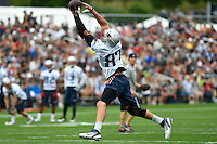 July 24, 2014 - Foxborough, Massachusetts, U.S.- New England Patriots tight end Rob Gronkowski (87) makes a leaping catch during the New England Patriots training camp held at Gillette Stadium in Foxborough Massachusetts. Eric Canha/CSM