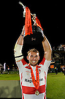 20130809 Copyright onEdition 2013 ©<br /> Free for editorial use image, please credit: onEdition.<br /> <br /> Martyn Thomas of Gloucester Rugby 7s holds the trophy aloft after winning the finals of the J.P. Morgan Asset Management Premiership Rugby 7s Series.<br /> <br /> The J.P. Morgan Asset Management Premiership Rugby 7s Series kicked off for the fourth season on Thursday 1st August with Pool A at Kingsholm, Gloucester with Pool B being played at Franklin's Gardens, Northampton on Friday 2nd August, Pool C at Allianz Park, Saracens home ground, on Saturday 3rd August and the Final being played at The Recreation Ground, Bath on Friday 9th August. The innovative tournament, which involves all 12 Premiership Rugby clubs, offers a fantastic platform for some of the country's finest young athletes to be exposed to the excitement, pressures and skills required to compete at an elite level.<br /> <br /> The 12 Premiership Rugby clubs are divided into three groups for the tournament, with the winner and runner up of each regional event going through to the Final. There are six games each evening, with each match consisting of two 7 minute halves with a 2 minute break at half time.<br /> <br /> For additional images please go to: http://www.w-w-i.com/jp_morgan_premiership_sevens/<br /> <br /> For press contacts contact: Beth Begg at brandRapport on D: +44 (0)20 7932 5813 M: +44 (0)7900 88231 E: BBegg@brand-rapport.com<br /> <br /> If you require a higher resolution image or you have any other onEdition photographic enquiries, please contact onEdition on 0845 900 2 900 or email info@onEdition.com<br /> This image is copyright the onEdition 2013©.<br /> <br /> This image has been supplied by onEdition and must be credited onEdition. The author is asserting his full Moral rights in relation to the publication of this image. Rights for onward transmission of any image or file is not granted or implied. Changing or deleting Copyright information is illegal as specified in the Copyright, Design and Patents Act 1988. If you are in any way unsure of your right to publis