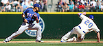 Seattle Mariners'  Logan Morrison (20) slides safely into second base as  Texas Rangers shortstop Elvis Andrus covers at SAFECO Field in Seattle on April 10, 2015.  The Mariners came from behind to beat the Rangers 11-10.  Jim Bryant Photo. ©2015. All Rights Reserved.