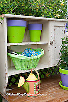 63821-20401 Potting bench with containers and flowers in spring, Marion Co. IL