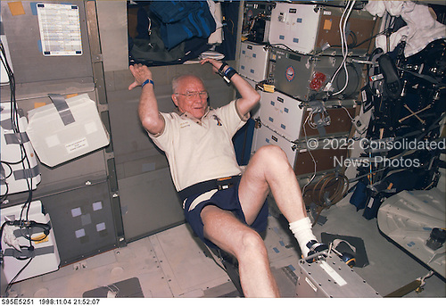 United States Senator John H. Glenn Jr. (Democrat of Ohio), payload specialist, STS95, works out on the ergometer device onboard Discovery. The photograph was taken with an electronic still camera (ESC) at 21:52:07 GMT, November 4, 1998..Credit: NASA via CNP
