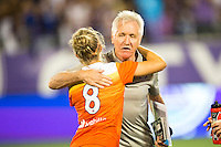 Orlando, Florida - Saturday, April 23, 2016: Orlando Pride head coach Tom Sermanni hugs Houston Dash defender Ellie Brush (8) following a 3-1 victory for the Pride during an NWSL match between Orlando Pride and Houston Dash at the Orlando Citrus Bowl.