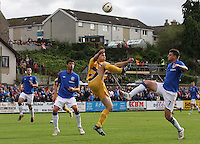 Scott Lawrie and Sebastien Faure of Rangers go in for the ball with the feet up as Emilson Cribari looks on in the Forres Mechanics v Rangers William Hill Scottish Cup 2nd Round match, at Mosset Park, Forres on 29.9.12.