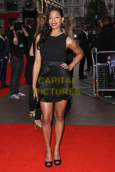 SHANIKA WARREN-MARKLAND .World Film Premiere of '4,3,2,1' at the Empire, Leicester Square, London, England, UK, May 25th 2010 .4321 4-3-2-1 arrivals full length black dress hand on hip peep toe platform shoes tiered pleated ruffles ruffle sleeveless.CAP/AH.©Adam Houghton/Capital Pictures.
