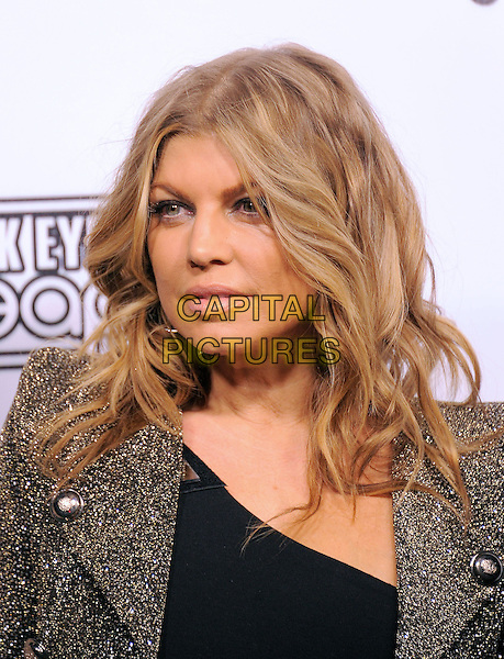 FERGIE aka STACY FERGUSON of BLACK EYED PEAS.The Black Eyed Peas & Friends Peapod Benefit Concert held at The Music Box in Hollywood, California, USA..February 10th, 2011.BEP headshot portrait brown gold jacket black .CAP/RKE/DVS.©DVS/RockinExposures/Capital Pictures.