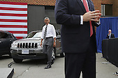 United States President Barack Obama walks out of the The Federal Highway Administration's Turner-Fairbank Highway Research Center after a tour July 15, 2014 in McLean, Virginia. According to the Department of Transportation, the center is home to '20 laboratories, data centers, and support facilities, and conducts applied and exploratory advanced research in vehicle-highway interaction, nanotechnology, and a host of other types of transportation research in safety, pavements, highway structures and bridges, human-centered systems, operations and intelligent transportation systems, and materials.'  <br /> Credit: Chip Somodevilla / Pool via CNP