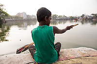 Bangladesh, Dhaka, Korail slum. Rafts made out of plastic bottles taking passengers across the river out to the slum.